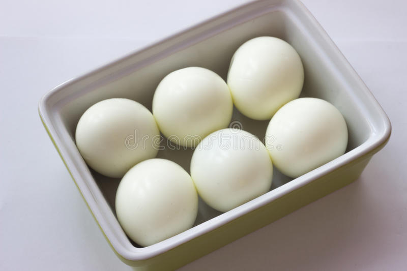 Eggs in green container. White eggs in green container royalty free stock photo