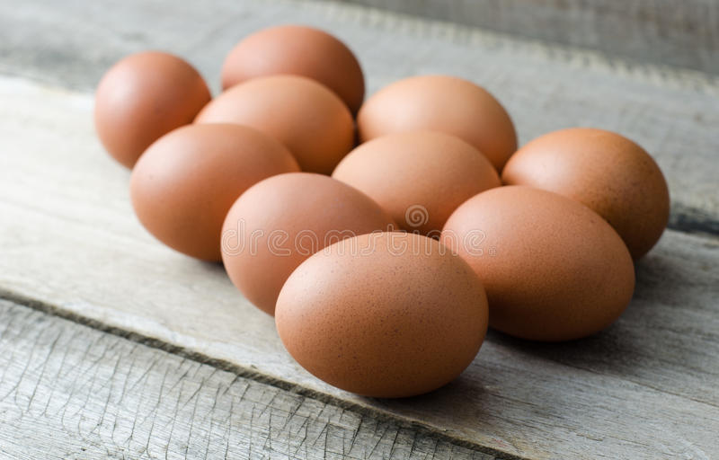 Eggs laid on a wooden - Still life. stock images