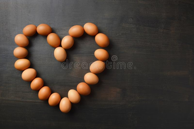 Eggs lined up in heart shape with copy space stock image