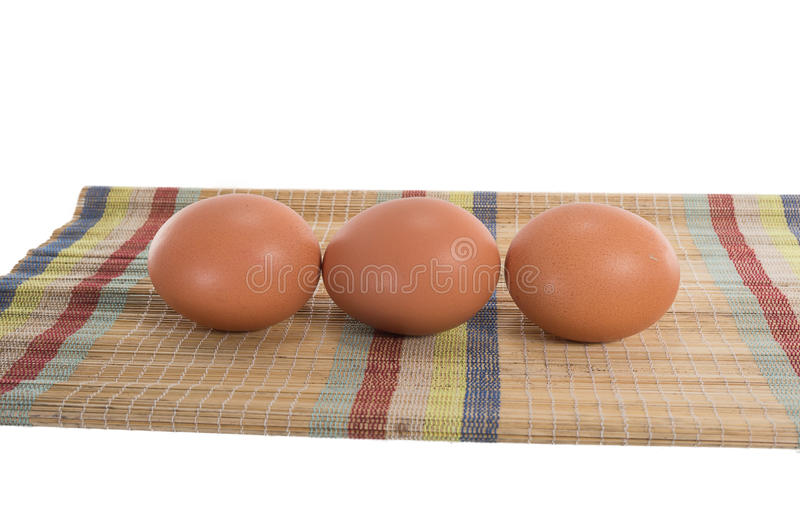 Eggs on the mat. In studio royalty free stock images