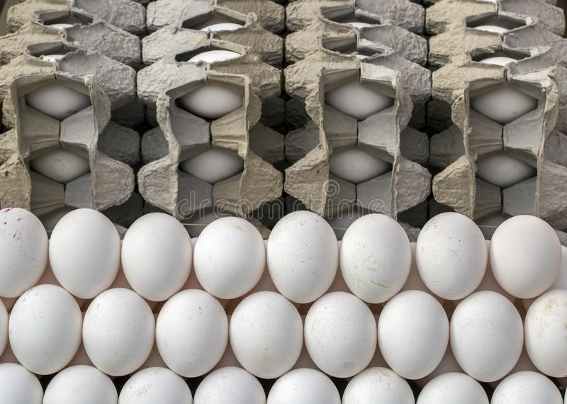 Eggs in packing on market bazaar stand stock images