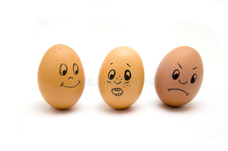 Eggs painted with emotions, psychology, feelings, communication and perception white background royalty free stock photo
