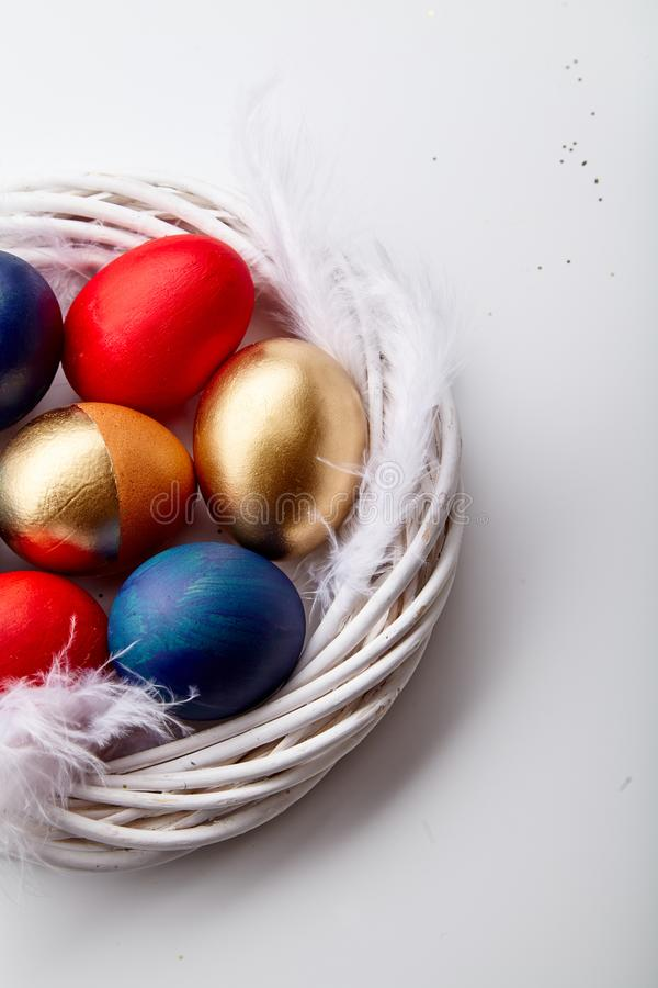 Free Eggs Painted Various Colors Arranged With Feathers In Twig Wreath Stock Photography - 107893482