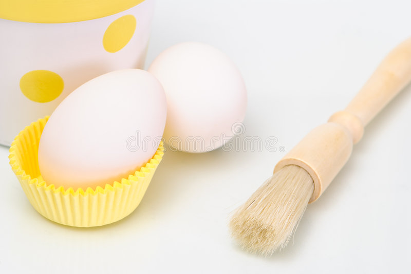 Eggs and Pastry Brush stock photography