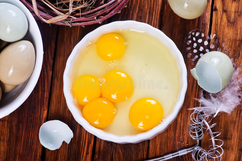Eggs pheasant. On a table, yolks of stock images