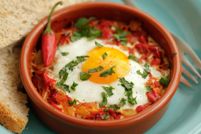 Eggs poached in tomato sauce royalty free stock image