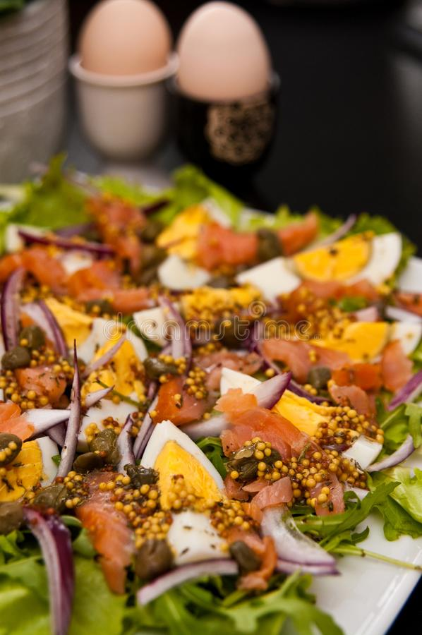 Eggs salad with salmon and capers stock photos