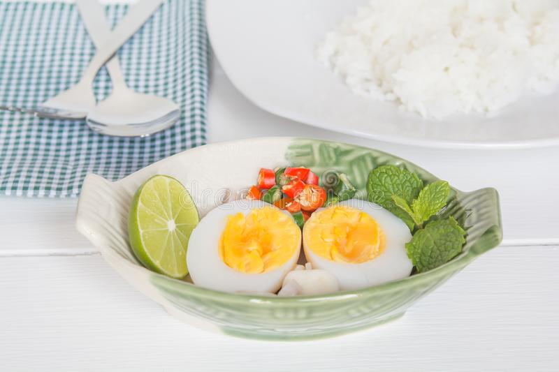 Eggs and spicy condiments. In a cup of the boat royalty free stock image
