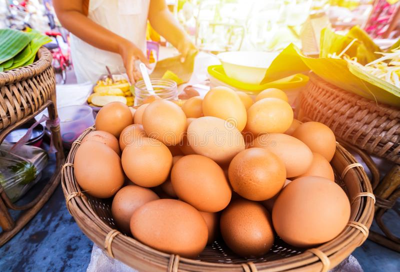Eggs on tray and chef make food. stock image