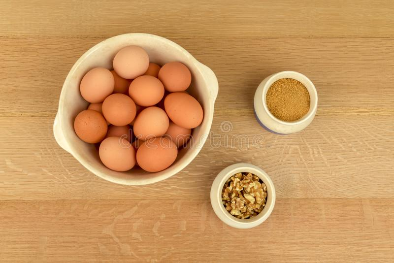 Eggs, Walnuts, Organic Sugar, Cinnamon, in Blue and White Bowls. stock images