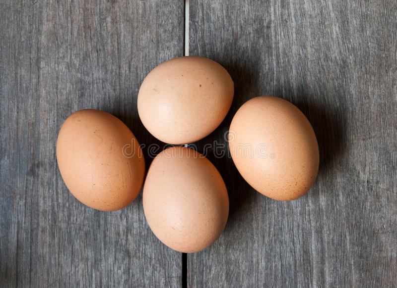 Eggs on wood. Brown eggs on wood background royalty free stock images