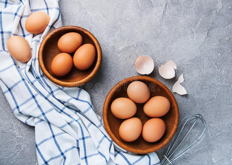 Eggs and wooden bowls royalty free stock photography