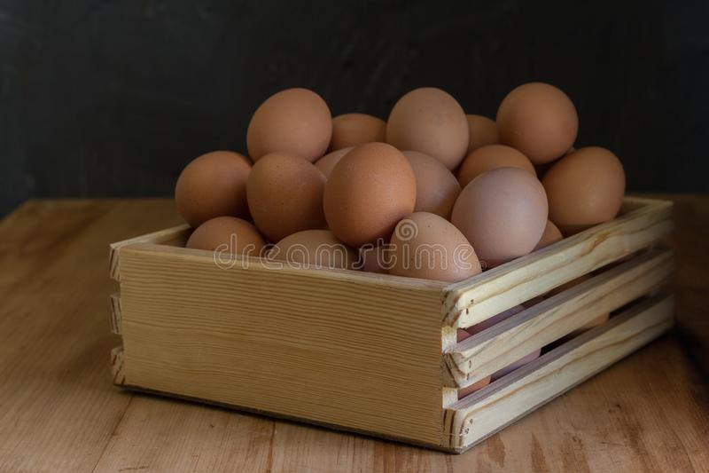 Eggs in a wooden egg tray stock photos
