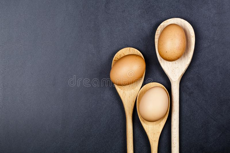 Eggs in wooden spoons royalty free stock photos