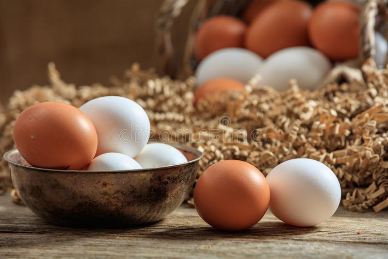 Eggs on a wooden surface. Brown eggs on a wooden surface stock image