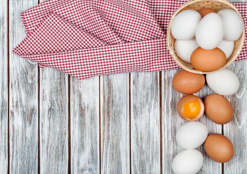 Eggs. On wooden table background royalty free stock images