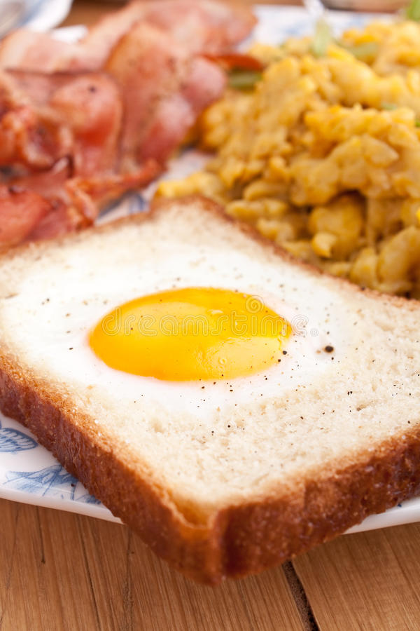 Download Eggy bread, eggs and bacon stock image. Image of strips - 10169289
