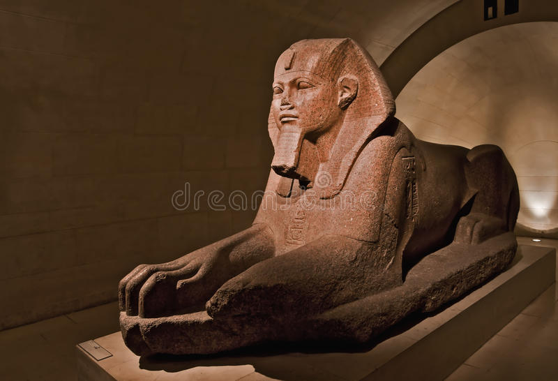 Egiptian tombstone statue. At the Louvre Museum stock photo