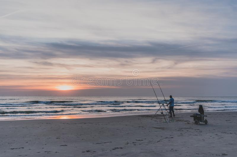 Egmond-aan-Zee, Netherlands - 09-24-2016: Angling on the North S stock photography