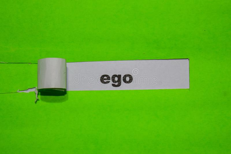 EGO, Inspiration and business concept on green torn paper stock photo