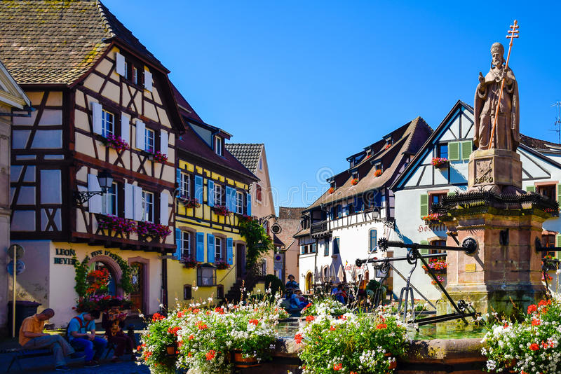 Eguisheim, France-June 23, 2016: Tourists are hanging around the square of Eguisheim, France. Eguisheim, France-June 23, 2016: Tourists are hanging around the royalty free stock images