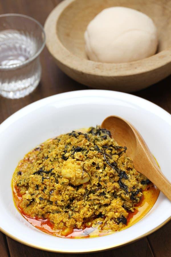 Egusi soup and fufu, nigerian cuisine. Egusi soup and pounded yam, nigerian cuisine royalty free stock photo