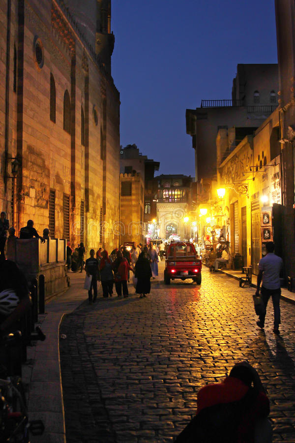 Egypt cairo street view. People walking in historical Moez street in old cairo in egypt royalty free stock images
