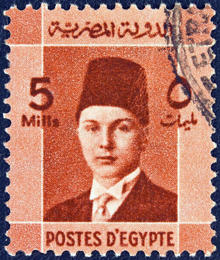 EGYPT - CIRCA 1937: A stamp printed in Egypt shows a portrait of King Farouk, circa 1937. EGYPT - CIRCA 1937: A stamp printed in Egypt issued for the royalty free stock photography