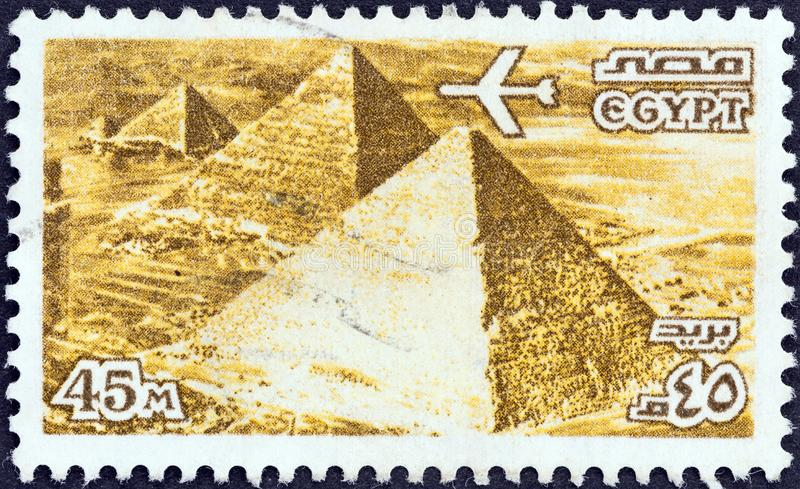 EGYPT - CIRCA 1978: A stamp printed in Egypt shows the Three Pyramids at Giza, circa 1978. EGYPT - CIRCA 1978: A stamp printed in Egypt shows the Three Pyramids stock photos