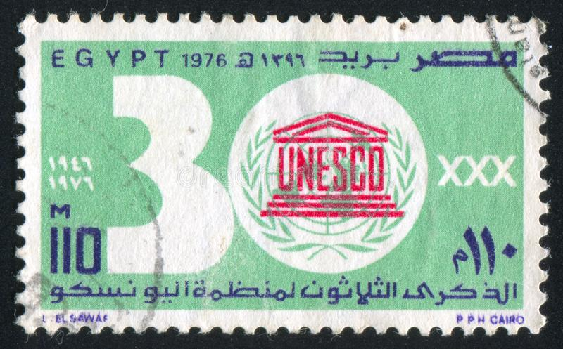 UNESCO emblem. EGYPT - CIRCA 1976: stamp printed by Egypt, shows UNESCO emblem, digits, circa 1976 royalty free stock photography