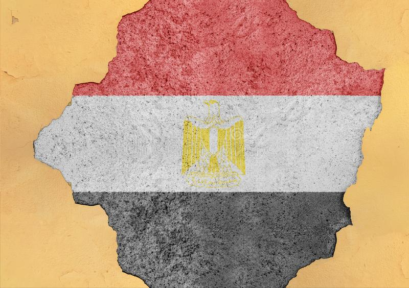 Egypt cracked hole and broken flag in big concrete material facade. Structure stock photo