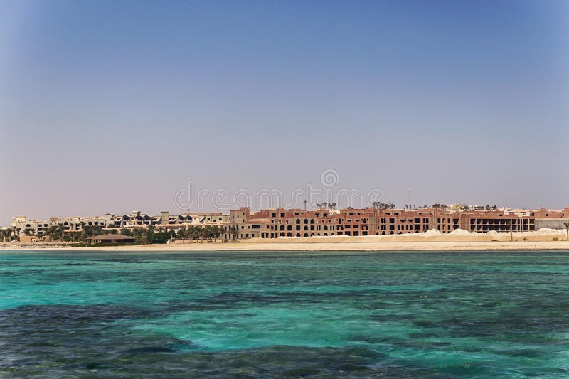 Egypt. Hurghada. Landscape from the sea vidneetsya horizon line. With an unfinished hotel royalty free stock images