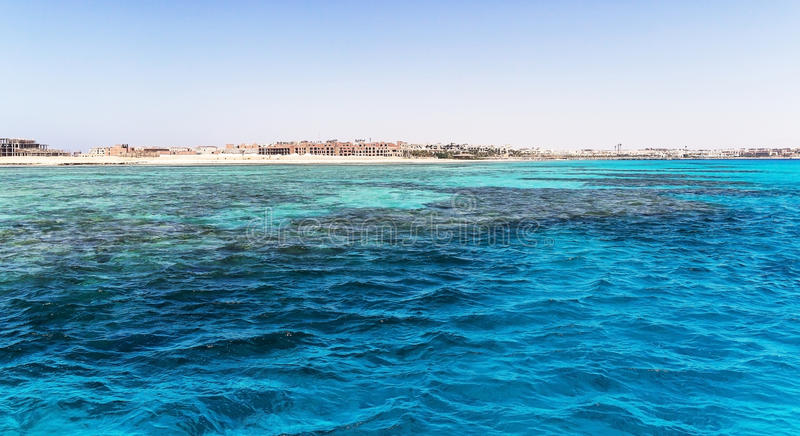 Egypt. Hurghada. Landscape from the sea vidneetsya horizon line. With an unfinished hotel royalty free stock image