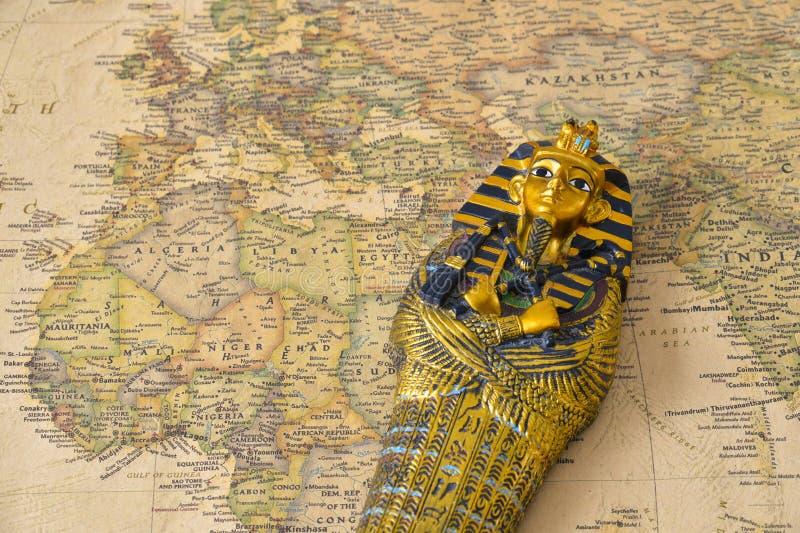Egypt map pharaoh. Egypt tourism concept - pharaoh Tutankhamun's sarcophagus on map stock photos