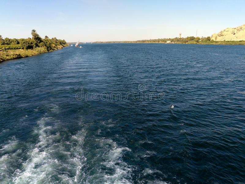 Egypt Nile cruise, a nice view from the boat to shore. A trail made by working m stock photography