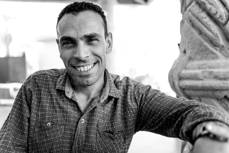 Positive portrait of affable arabian seller stock photo