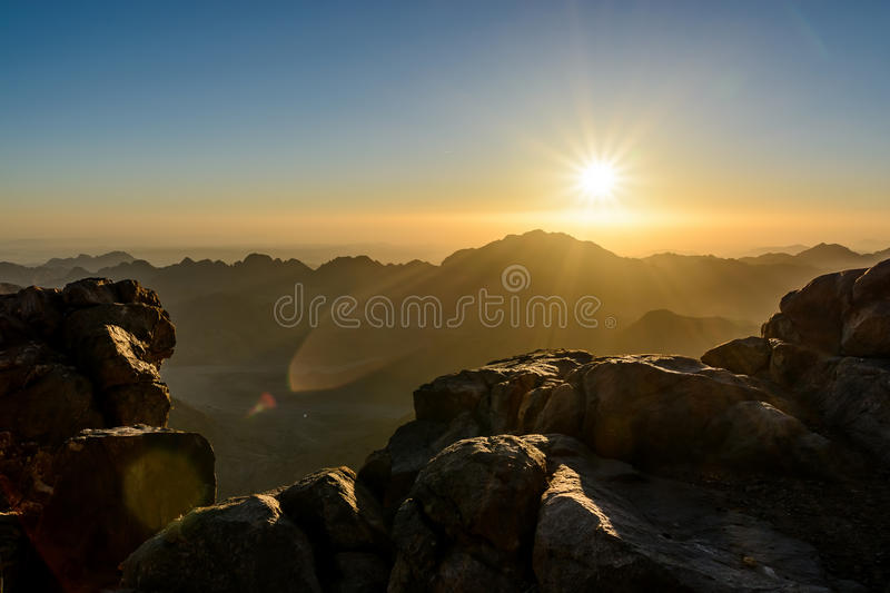 Egypt, Sinai, Mount Moses. View from road on which pilgrims climb the mountain of Moses and dawn - morning sun with rays on the sk stock photo