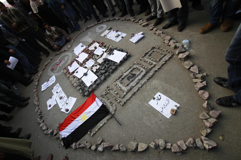 Egypt - Tahrir Square. Stones that were used to attack protesters in Tahrir square used to create a heart shaped monument for the January 25th revolution and stock image