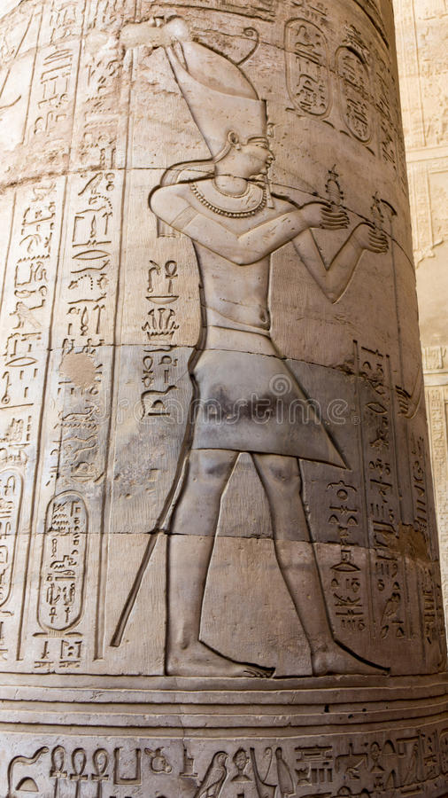 Egyptian ancient temple engravings on. The wall royalty free stock photography