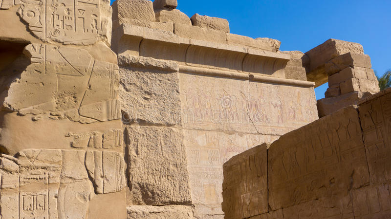 Egyptian ancient temple engravings on. The wall royalty free stock photos
