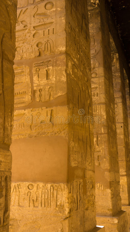 Egyptian ancient temple engravings on. The wall stock photos