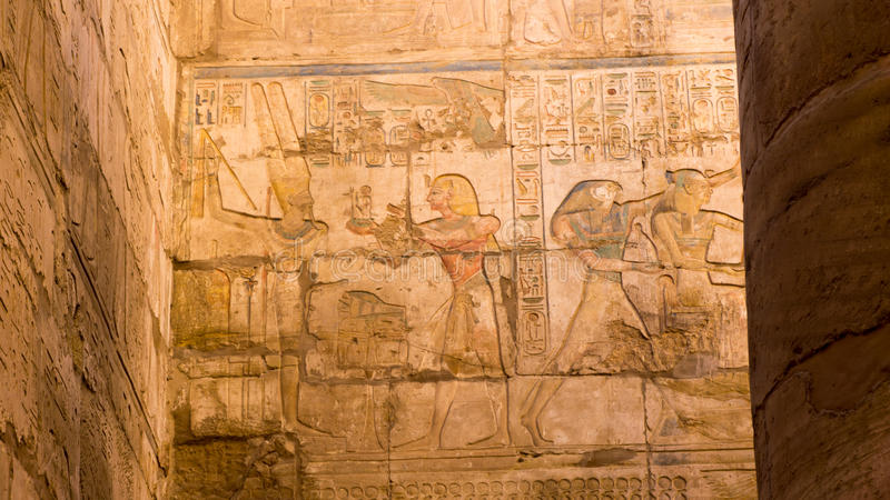 Egyptian ancient temple engravings on. The wall stock images