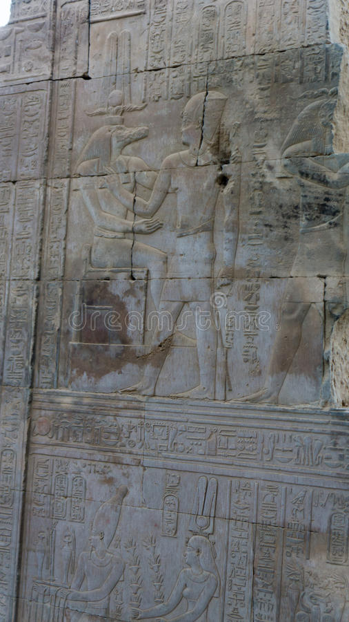 Egyptian ancient temple engravings on. The wall royalty free stock image