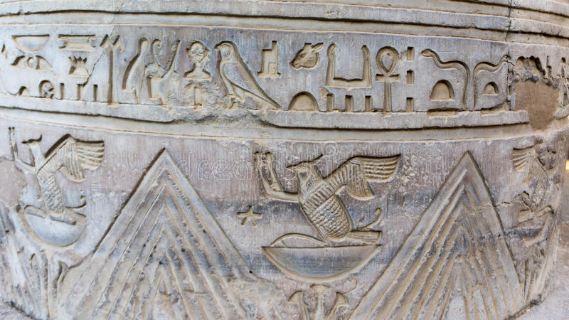 Egyptian ancient temple engravings on. The wall stock photo