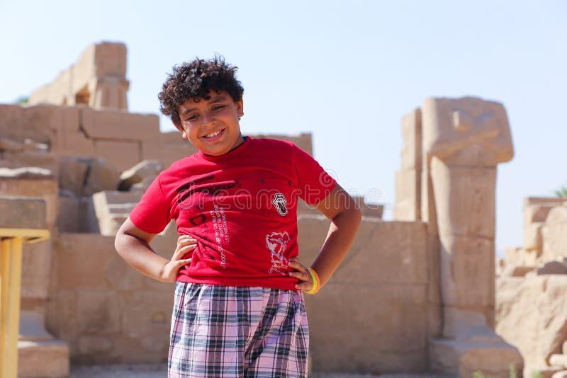 Egyptian child at Karnak Temple at Luxor - Egypt. Architecture of Karnak Temple at Luxor - Egypt Karnak temple most huge temple at Egypt royalty free stock image