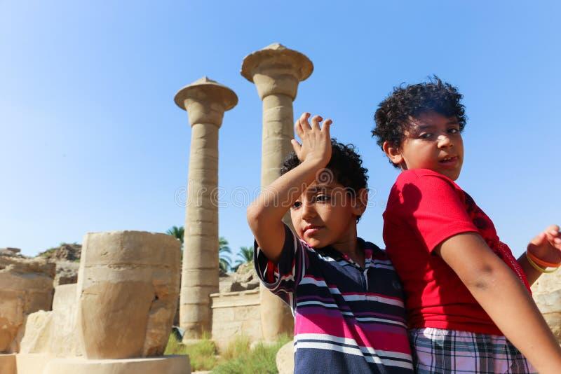 Egyptian children at Karnak Temple at Luxor - Egypt. Architecture of Karnak Temple at Luxor - Egypt Karnak temple most huge temple at Egypt stock photos