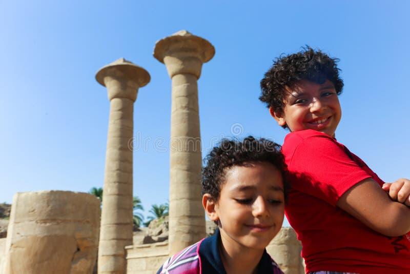 Egyptian children at Karnak Temple at Luxor - Egypt. Architecture of Karnak Temple at Luxor - Egypt Karnak temple most huge temple at Egypt royalty free stock photography