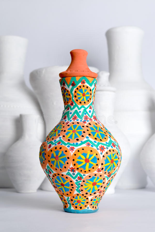 Egyptian decorated colorful pottery vase on background of white vases. Egyptian decorated colorful pottery vase (arabic: Kolla) on blurred background of white vector illustration