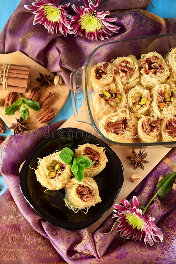 Egyptian dessert Kunafa made of kataifi dough with pistachio and pecan nuts royalty free stock image
