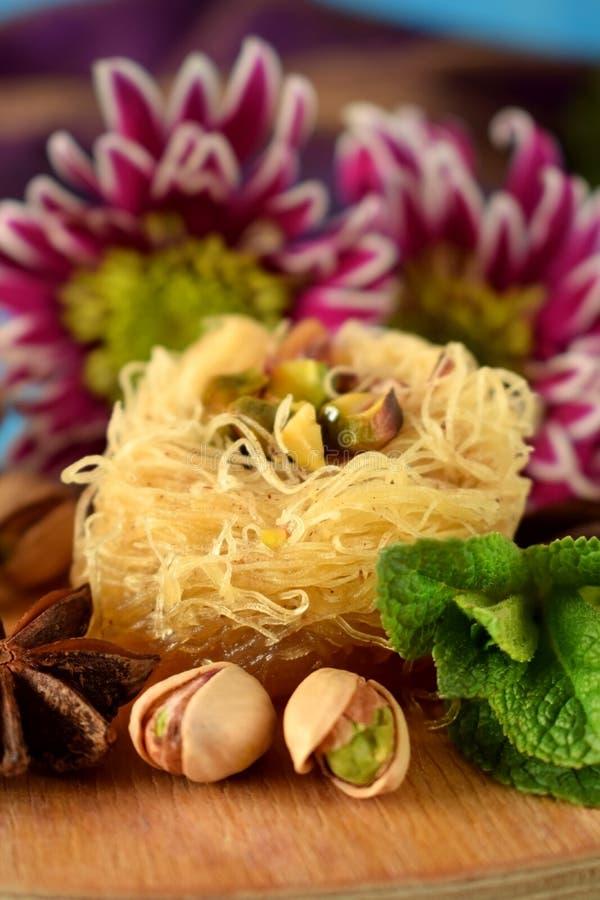 Egyptian dessert Kunafa made of kataifi dough with pistachios stock photography